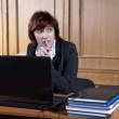 The woman at office behind the laptop — Stock Photo