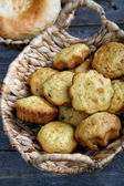 Rolls in a wattled basket on an old kitchen table — Stock Photo