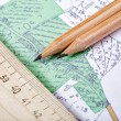 Stock Photo: Topographic map and pencils close up
