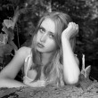 Black-and-white portrait of the girl in forest — Stockfoto