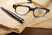 Still-life with old writing-books a nib — Stock Photo