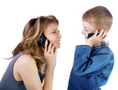Girl and  boy talk by a cellular telephone — Stock Photo