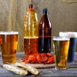Stock Photo: Light and dark beer with crayfish and dried fish
