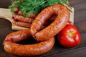 Smoked sausage on a kitchen table — Stock Photo