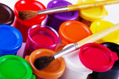 Jars of gouache and brush for drawing — Stock Photo