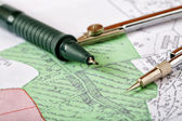 Topographic map of district with a measuring instrument and penc — Stock Photo