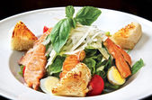 Caesar salad with salmon — Stock Photo