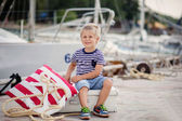 Boy of four on jetty by the sea — Stock Photo