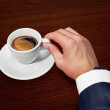 Businessman and cup of coffee — Stock Photo