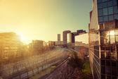Solnedgång i kontorsbyggnader — Stockfoto