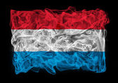 Rauchigen flagge luxemburgs — Stockfoto