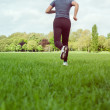 Stock Photo: Girl running on meadow