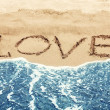 Lettering LOVE on the beach — Stock Photo