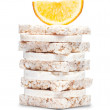 Sweet corn crackers and orange — Stock Photo
