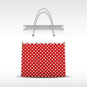 Vintage shopping bag in retro polka dots — Stock Vector