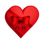 Gift box with red ribbon in the form of heart. — Stock Photo