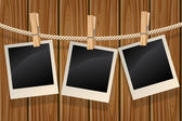 Fotos, die an einer wäscheleine hängen — Stockvektor