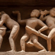 Panoramof erotic bas relief, Khajuraho, India — Stock Photo #13335573