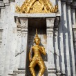 Gold guard on tower, Wat Phi, Thailand — Stock Photo