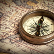 Old vintage compass on ancient map — Stock Photo #13336187