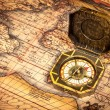 Vintage pirate compass on ancient map — Stock Photo