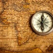 Old vintage compass on ancient map — Stock Photo #13336201