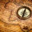 Old vintage compass on ancient map — Stock Photo #13336204