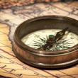 Old vintage compass on ancient map — Stock Photo #13336218