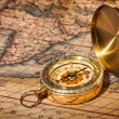 Old vintage golden compass on ancient map — Stock Photo #13336219
