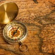 Old vintage golden compass on ancient map — Stock Photo #13336223