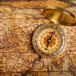 Old vintage golden compass on ancient map — Stock Photo #13336225