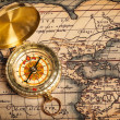 Old vintage golden compass on ancient map — Stock Photo #13336227