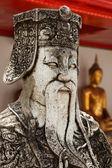 Wat Pho stone guardian face close up, Thailand — Stock Photo