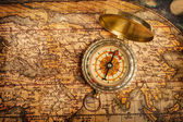 Old vintage golden compass on ancient map — Stock fotografie