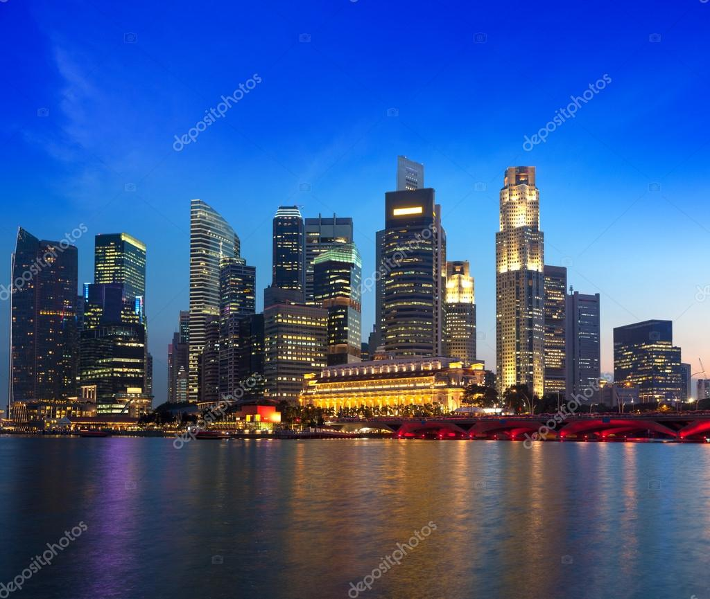Singapore skyline and river in evening — Stock Photo #13335616
