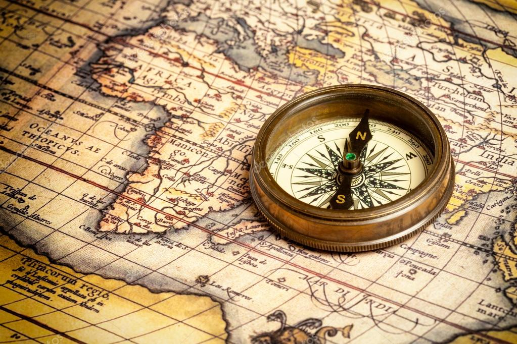 Old vintage retro compass on ancient map  Stock Photo #13336192