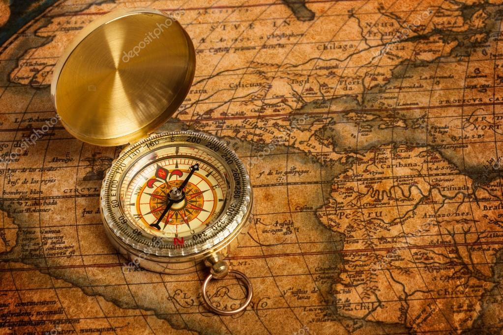 Old vintage retro golden compass on ancient map — Stock Photo #13336223
