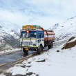 Manali-Leh road in Indian Himalayas with lorry - Stock Photo