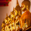 Stock Photo: Sitting Buddha statues, Thailand