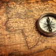 Old vintage compass on ancient map — Stok fotoğraf #13631959