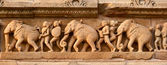 Stone carving bas relief panorama, Lakshmana Temple, Khajuraho, — Stock Photo