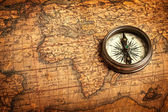 Old vintage compass on ancient map — Stockfoto