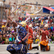 Dancers in traditional Ladakhi Tibetan costumes perform warlike - Stock Photo