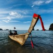 Long tail boat on beach, Thailand - Stock Photo