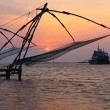 Chinese fishnets on sunset. Kochi, Kerala, India - Stock Photo