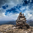 Stone cairn in Himalayas - Stock Photo
