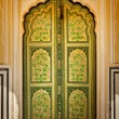Wooden old ornamented door vintage background - Stock Photo