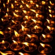 Burning candles in Tibetan Buddhist temple — Stock Photo #25475921