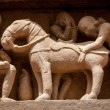 Erotic bas relieves, Khajuraho, India — Stock Photo #25476291