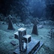 Stock Photo: Spooky Halloween graveyard in fog